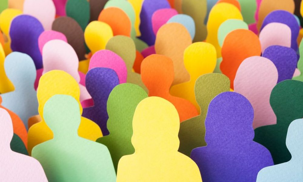 Lots of multicolored men and women silhouettes made with paper for crowd concept